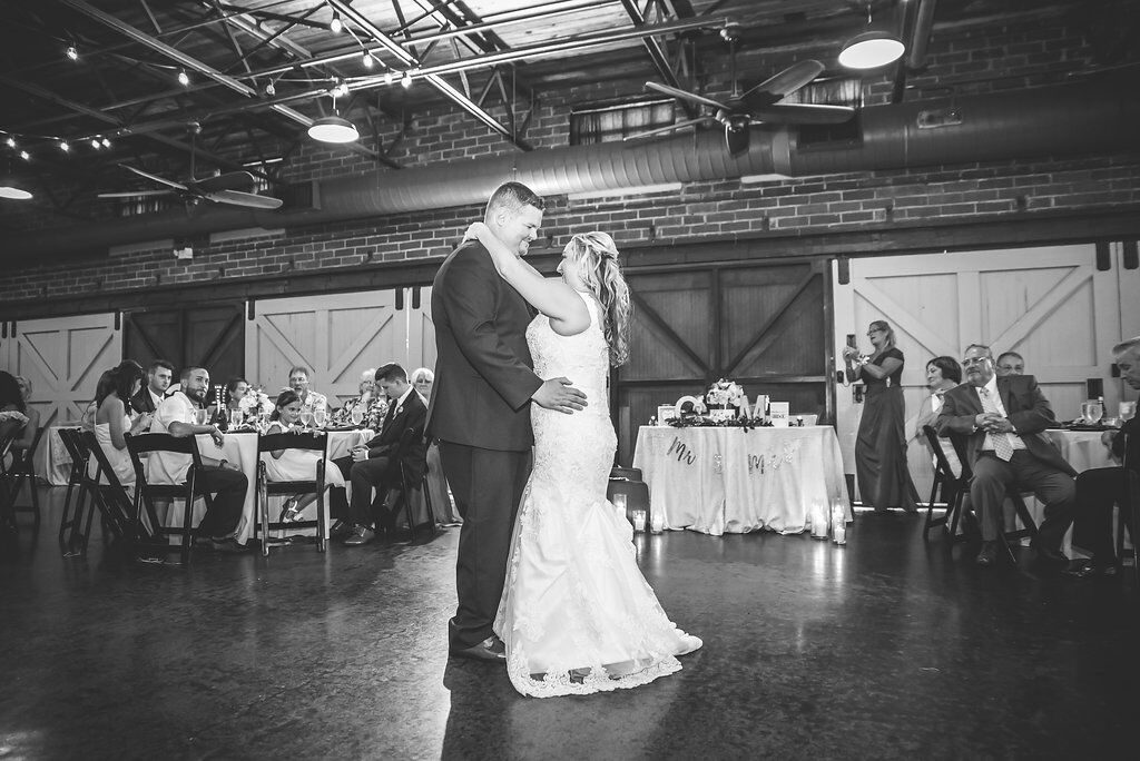 bride and groom dancing alone