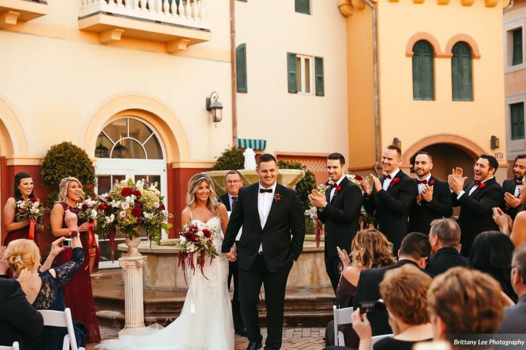 Alex and Kim's wedding ceremony outdoors at the Loew's Portofino Bay Hotel.