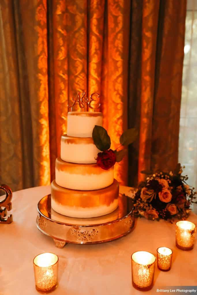white and gold ombre tiered wedding cake