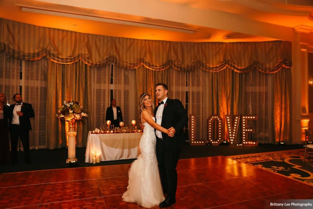 bride and groom share first dance at Portofino Bay Hotel