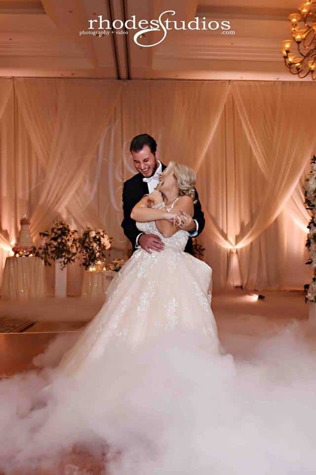 bride and groom share first dance on a cloud