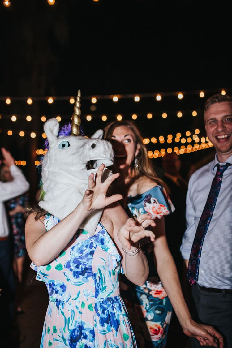 woman in unicorn head on dance floor