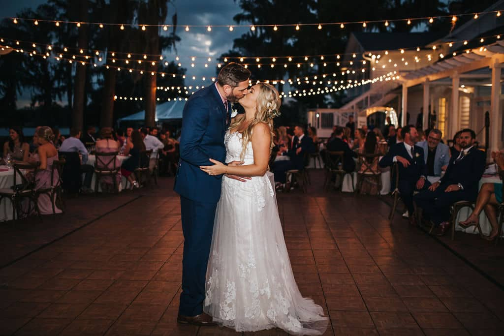 Albina and Scott share their first dance at their outdoor wedding reception.