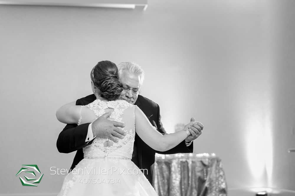 Black and white image of Grace dancing with her father.