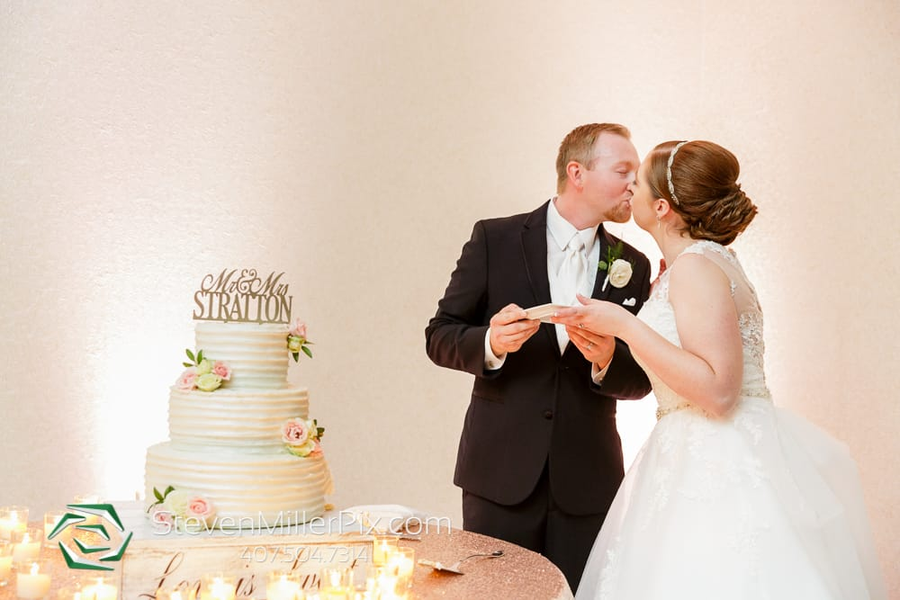 Grace and Ryan kissing after cake cutting ceremony.