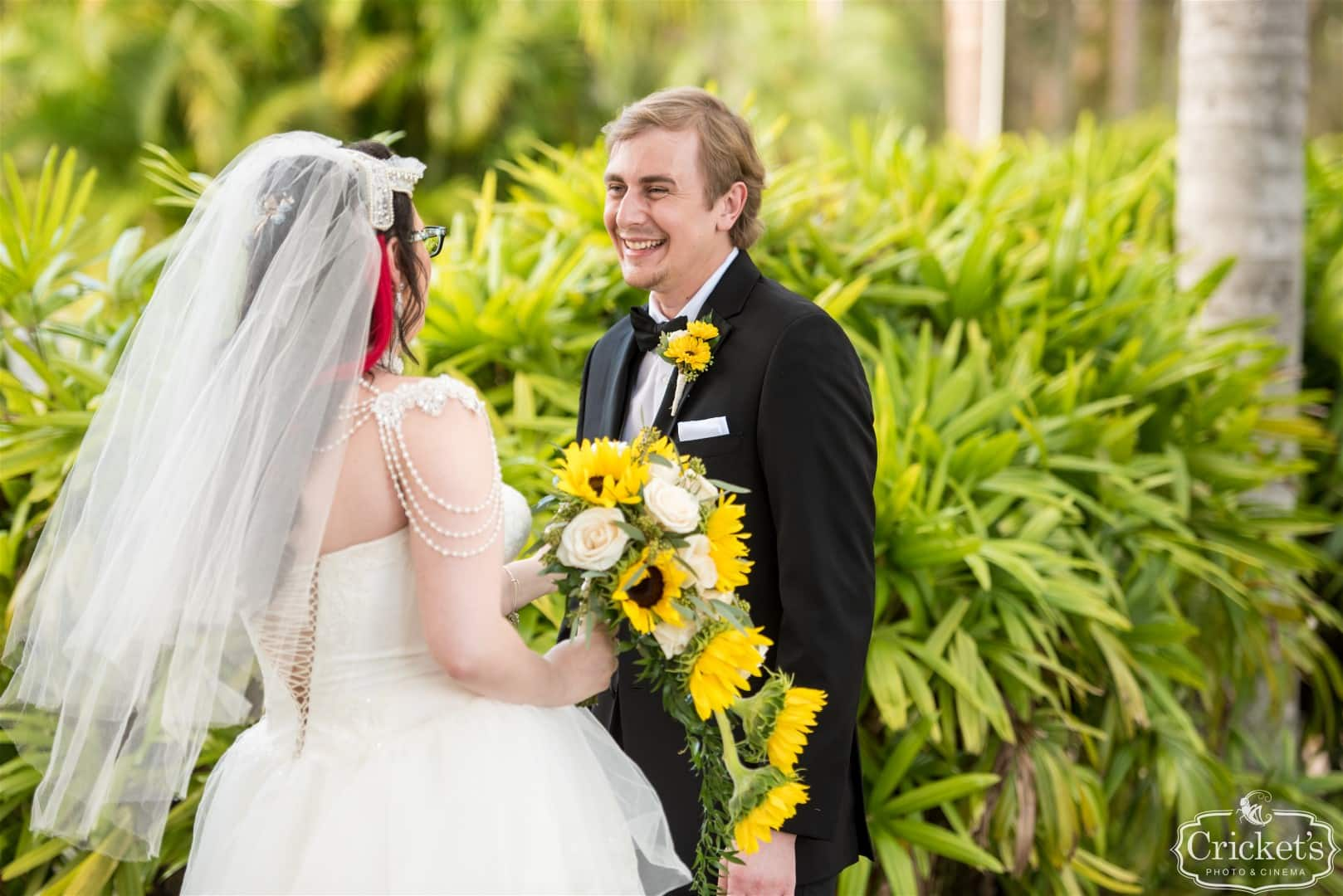 bride and groom laughing at each other