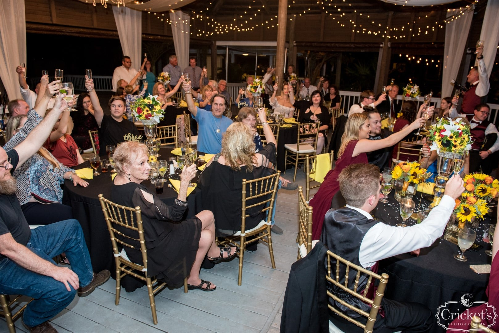 wedding guests raising glasses to toast