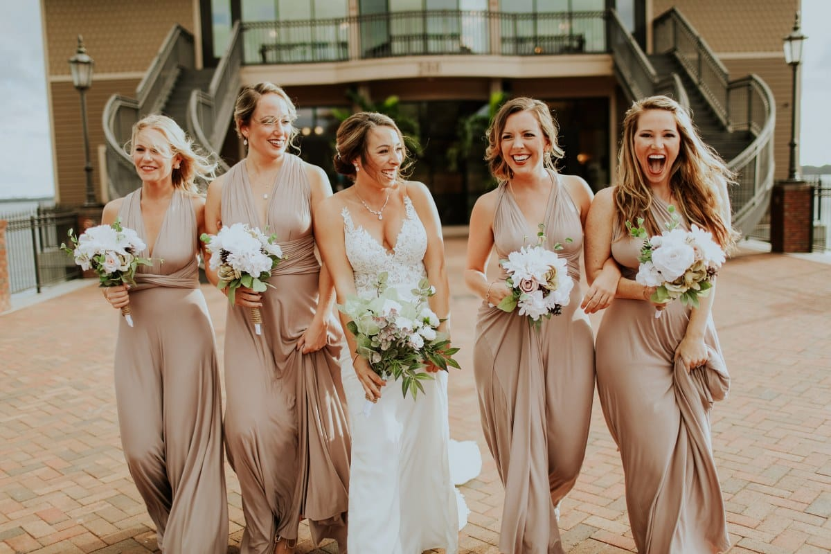 bride with bridesmaids in champagne dresses