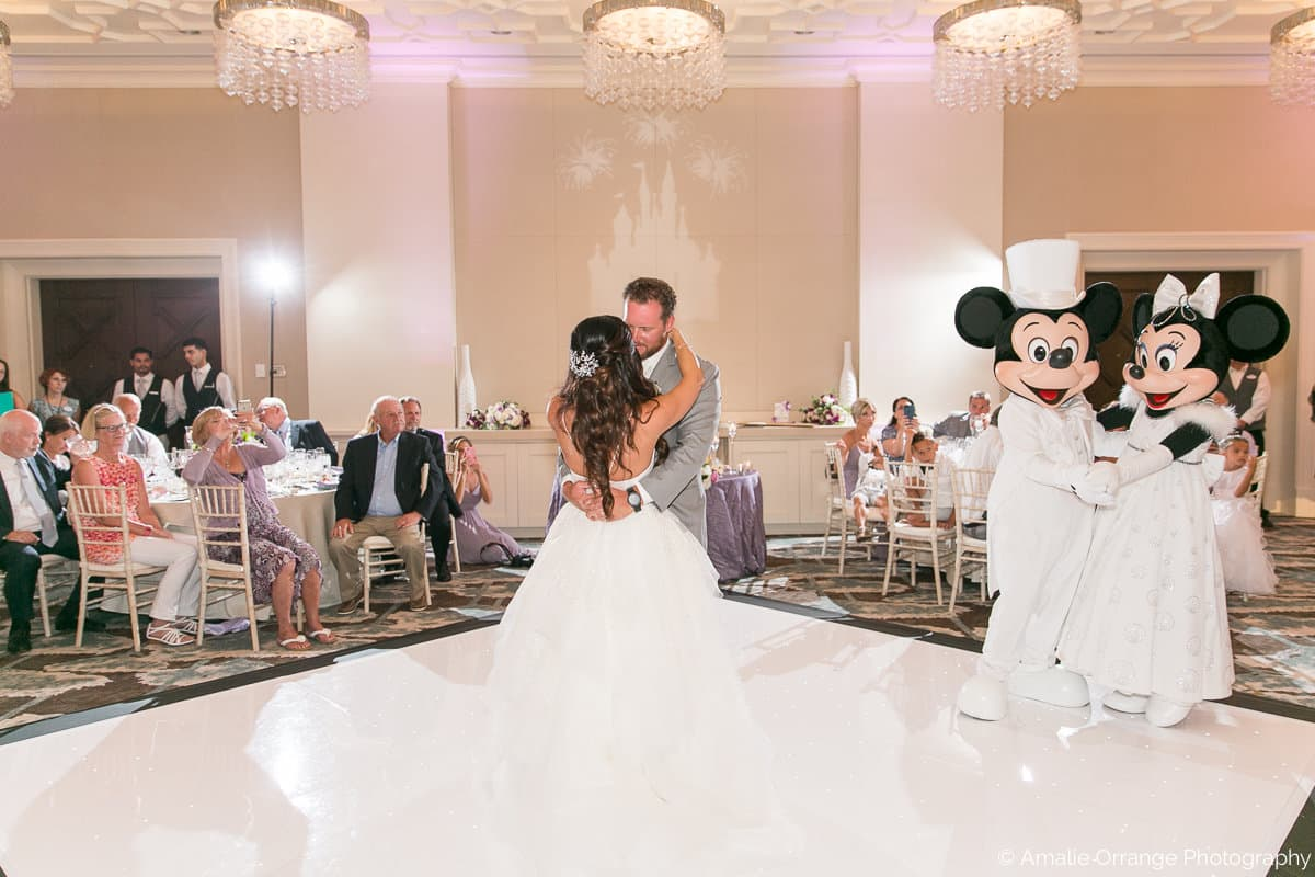 bride and groom sharing first dance with Minnie and Mickey