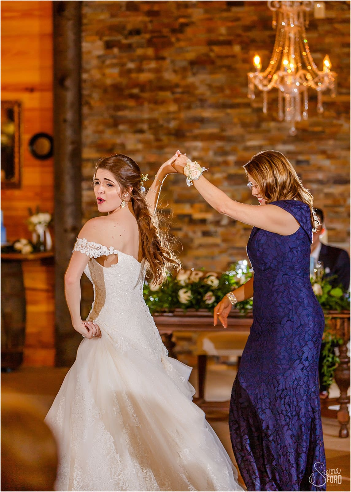 Bride dancing with mother