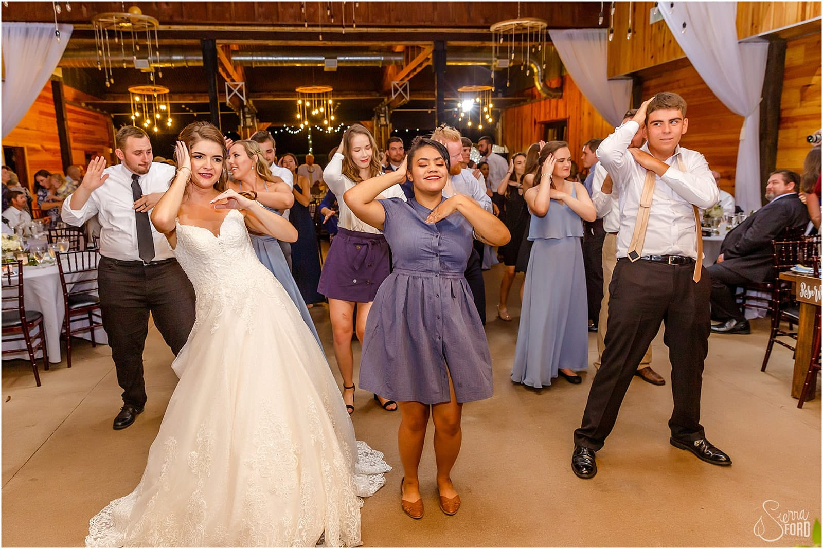 bride and guests doing macarena