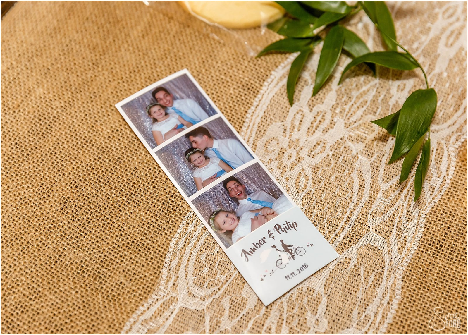 photo strip on burlap/lace table